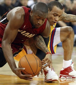 Dwyane Wade and Monta Ellis fight for the ball during Wednesday's game.